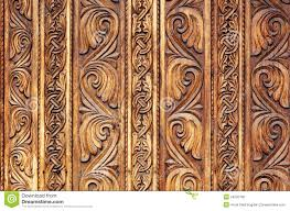 old hand carved wooden pattern on a monastery door stock photo