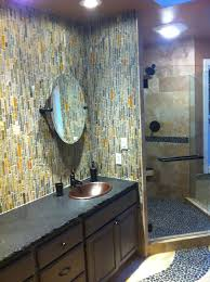 natural stone tile shower with river rock floor and slate mosaic