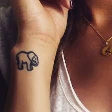small elephant on wrist