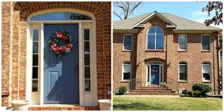Brick Homes by Blue Front Door Color For Brick House Mixed With Christmas Wreath