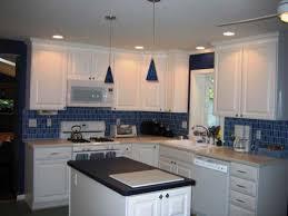 blue subway tile backsplash in kitchen