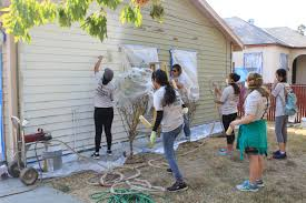 sac state students city members repaint houses in del paso