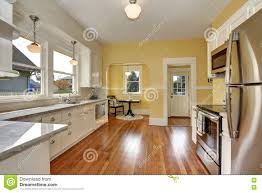 Kitchen Yellow Walls - kitchen yellow wood cabinets stainless stove stock photos images