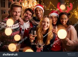 portrait friends festive jumpers christmas party stock photo