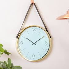 stay on time with this golden rimmed wall clock a quirky take on