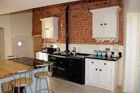 exposed brick kitchen splashback shapely molded wood bar stool