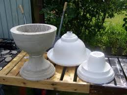 cheap plastic urn turned into concrete mold very nice diy