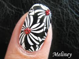 konad stamping nail art pinwheel flower design black and white