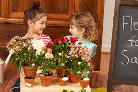 Arranging Flowers by Budding Minds Imagination Blooms In This Pop Up Flower Shop