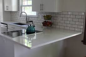 kitchen cabinets with white quartz countertops clean white kitchen cabinets and quartz countertops
