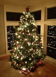home decorating tree with white snow and lights for