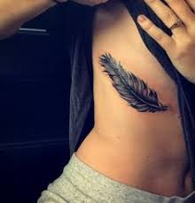 20 feather tattoo ideas for women feather rib tattoos henna