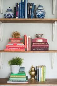 Organizing Bookshelves by The Art Of Bookshelf Arranging Organizing Book Shelves And Shelves