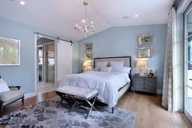 barn door bedroom with bedroom transitional and linen headboards