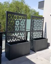 cog pattern laser cut screens with integrated planter boxes at the