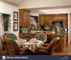 Dining Room Tile by Kitchen Dining Room With Wicker Chairs Green Tile And Window Stock