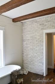 Simple Bathroom Simple Bathroom With Brick Wall White Tub And Wooden Floor Dweef