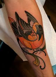 oriole bird tattoo by tattoo artist dave wah at stay humble tattoo