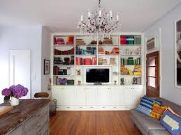 living room simple living room wooden open shelf around tv wall