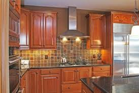 slate backsplash in kitchen cherry cabinets and slate backsplash