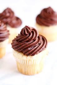 easy vanilla cupcakes with creamy chocolate frosting baking ginger
