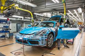 miami blue porsche boxster porsche 718 cayman hits the assembly line