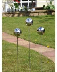 stainless steel obelisk garden ornament iron sphere rusted in