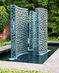 bronze waterfall wall with gold leaf backing curved water wall