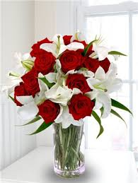 roses and lilies these look pretty together and bouquet lilies and