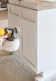 how to paint kitchen cabinets sprayer how to paint cabinets with a sprayer craving some creativity