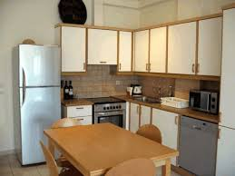 Steel Frame Kitchen Cabinets Smooth White Wooden Kitchen Cabinet Black Glass And Steel Oven