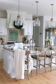 White Kitchens With Islands by Stunning White Kitchen With Silver Lanterns And Dark Leather