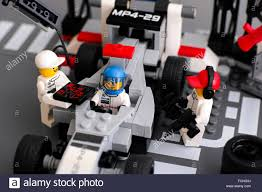 lego mclaren mp4 29 race car with driver and team crew members in mclaren