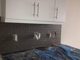 white ceramic subway tile kitchen backsplash with glass accent