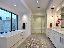 modern master bathroom with stone tile u0026 frameless showerdoor in