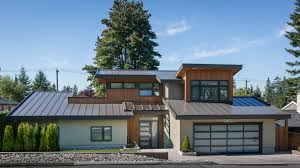 modern custom home front elevation metal roof environmentally