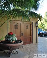 terranean carriage house style garage doors that swing open for pedestrians terranean shed
