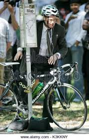 brad pitt rides a bike on the set of his movie in new york city