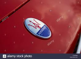 maserati sports car maserati sports car badge and radiator grill stock photo royalty
