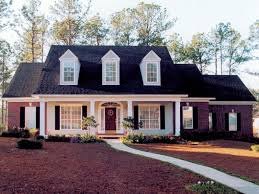 covered porch house plans 1950 cape cod brick front brick home with sweeping front covered