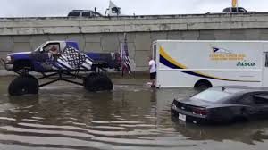 monster truck pulls vehicles houston flooding