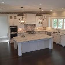 classic charleston style farmhouse kitchen with brick backsplash