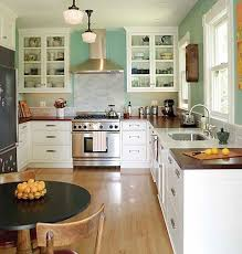 Butcher Block Counter Tops In Blue And White Kitchen White - White kitchen cabinets with butcher block countertops