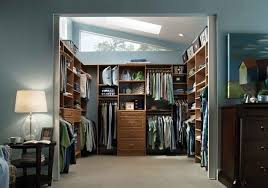 simple brown stained wooden floating closet system master bedroom