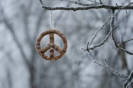 frozen peace sign hanging alone in the winter forest stock image