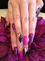pink and black gelish gel polish with freehand nail art and