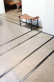 concrete floor with metal inlay designing borders