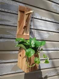indoor or outdoor wooden cedar barn door style wall sconce hanging