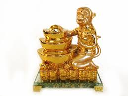 golden monkey statue with feng shui ingot for year of the monkey 2016