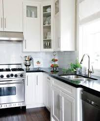 White Kitchen Cabinets With Black Granite Black Kitchen Cabinets With White Countertops Transitional